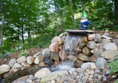 waterfall with garden gnome
