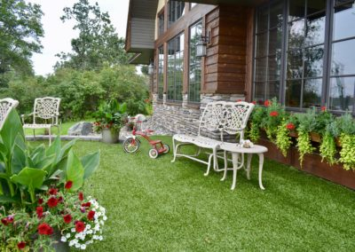 patio area with artificial turf